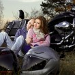 Smiling couple on motorcycle  — Stock Photo