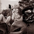 Smiling couple on motorcycle — Stock Photo #13739679