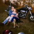 Beautiful couple in motorcycle — Stock Photo