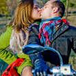 Royalty-Free Stock Photo: Beautiful couple sitting on the bike and kisses