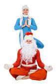 Noel Baba ve yoga kar kızlık — Stok fotoğraf