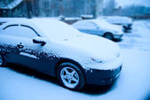 Snow-covered cars in the parking lot — Stock Photo