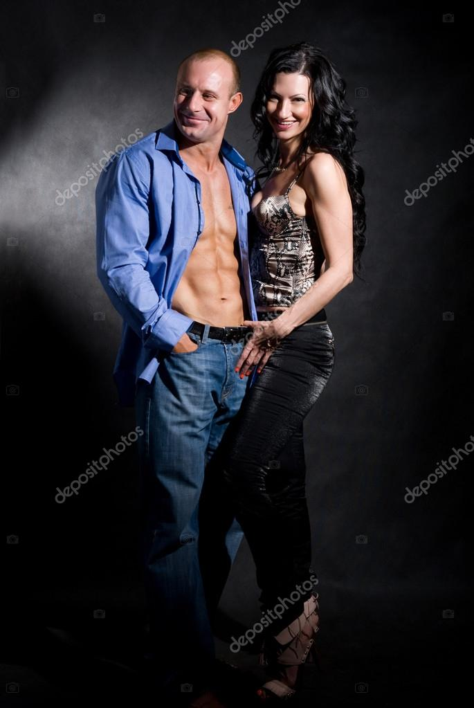 Muscular handsome sexy man with pretty woman on dark background — Stock Photo #14871467