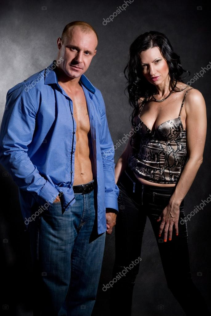 Muscular handsome sexy man with pretty woman on dark background  Stock Photo #14871477