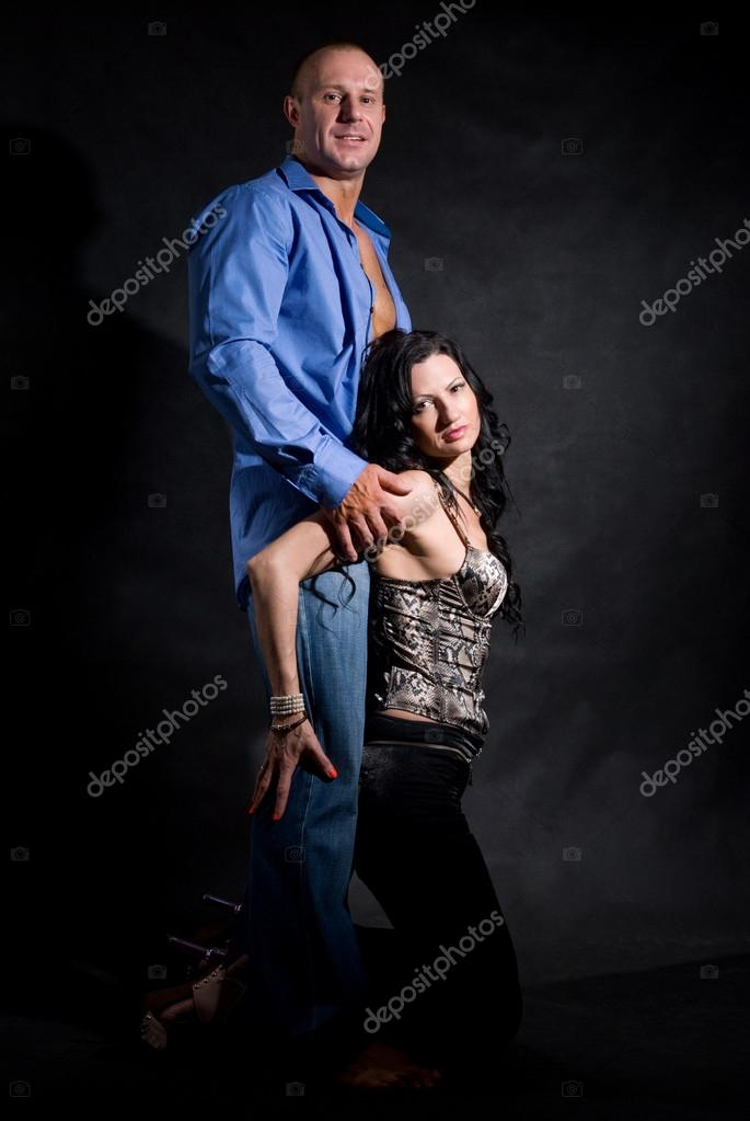 Muscular handsome sexy man with pretty woman on dark background — Stock Photo #14871499