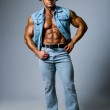 Muscular man in a cowboy hat — Stock Photo