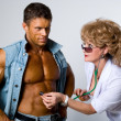 Female doctor checks a patient — Stock Photo #15839669