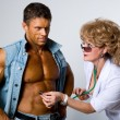 Stock Photo: Female doctor checks patient