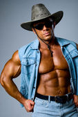 Handsome muscular man in a cowboy hat — Stock Photo
