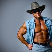 A handsome man in a cowboy hat — Stock Photo