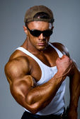 Bodybuilder strong athletic man show muscle arm — Stock Photo