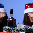 Stock Photo: Rejection of alcohol two girls in New Year hats