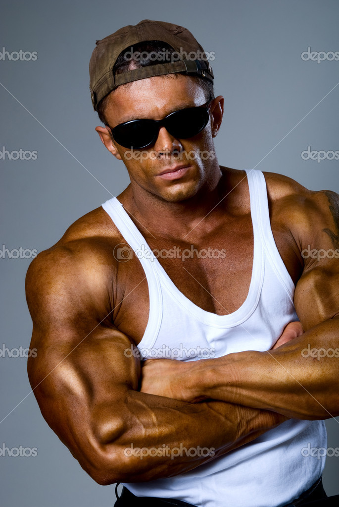 Handsome muscular man on gray background. — Stock Photo #16931229