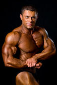 Posing man bodybuilder — Stock Photo
