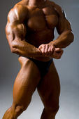 Handsome muscular bodybuilder in studio — Stock Photo