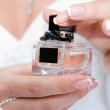 The bride with a bottle of perfume — Stock Photo