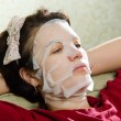 Portrait  woman applying rejuvenating facial mask on her face — Stock Photo