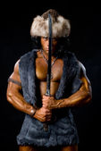 Male warrior with sword raised. — Stock Photo