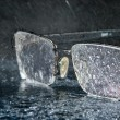 Stock Photo: Rain and glasses lying on mirror surface with water drops