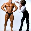 Woman studying male body muscular men — Stock Photo