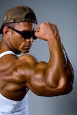 Athletic man showing his muscles — Stock Photo
