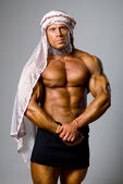 Muscular male wearing a Middle Eastern headdress — Stock Photo