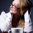 Thoughtful business woman with a cup of coffee — Stock Photo #23722695