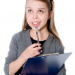 Young thoughtful girl with a clipboard and pen — Stock Photo #23723107