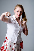 Portrait of an attractive young female punching — Stock Photo