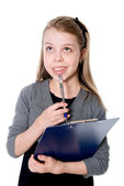Young thoughtful girl with a clipboard and pen — Stockfoto