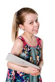 Young girl with tablet computer — Stock Photo