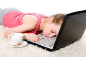 Tired girl sleeping on the laptop — Stock Photo
