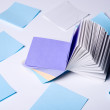 Stock Photo: Stack of colorful. Paper records lying on light background