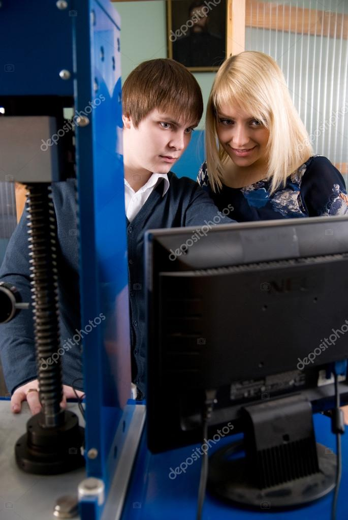 Two students in front of the monitor in the workshops � Stock ...