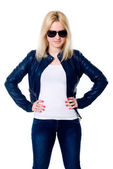 Young girl in a leather jacket and dark glasses — Stock Photo