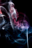 Mistery beautiful smoke on the black background — Stock Photo