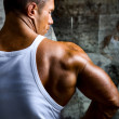 A beautiful young muscular man's shoulder — Stock Photo