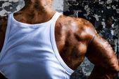 A beautiful young muscular man's shoulder. — Stock Photo