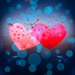 Two red hearts on a blue background. — Stock Photo