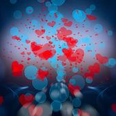 Corazones rojos sobre un fondo azul para tarjeta de felicitación — Foto de Stock