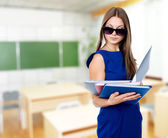 Portrait of a beautiful business woman with folders — Stock Photo