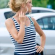 Stock Photo: Beautiful girl waiting in the street against white cars