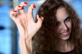 A girl with a terrible frightening hand, crooked fingers — Stock Photo
