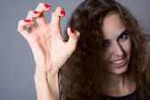 A girl with a terrible frightening hand — Stock Photo