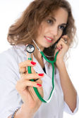 Doctor holding a stethoscope. Stethoscope in focus — Stock Photo