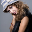 Beautiful girl in warm hat looks into the camera — Stock Photo #35194385