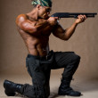 Strong athletic man with a gun. Special Forces soldier — Stock Photo