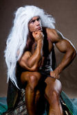 Handsome muscular man in a pose of a thinker. — Stock Photo
