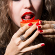 Beautiful girl eats a sandwich with red caviar — Stock Photo