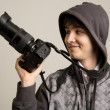 Portrait of cheerful young photographer with professional came — Stock Photo #40013593